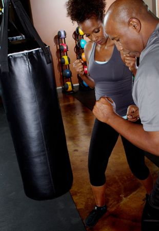 group fitness trainer showing proper punching technique