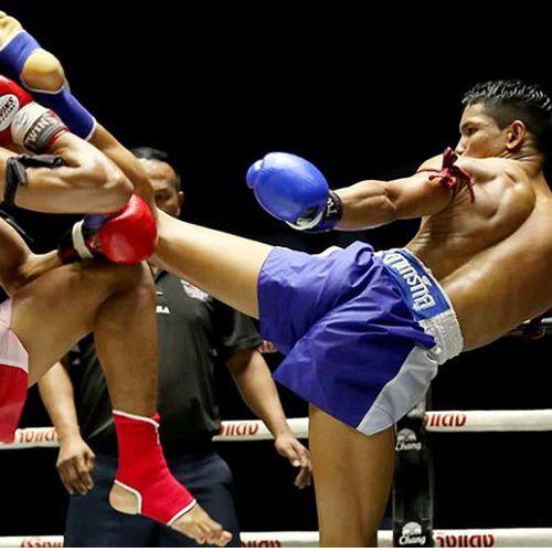 men kickboxing in a ring