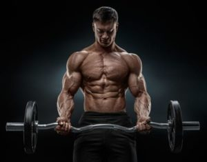 very muscular man doing bicep curls with a curling bar