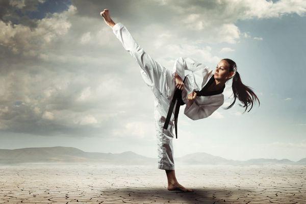 karate girl doing high side kick